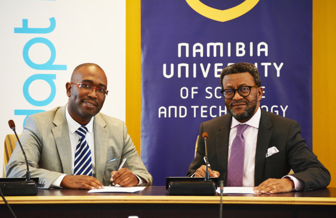 Luxolo Rubushe, Managing Director: AdaptIT (left) and Dr Tjama Tjivikua, NUST Vice-Chancellor (right), signing the Memorandum of Agreement.