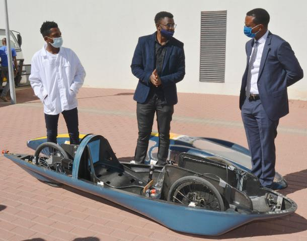 The Vice-Chancellor (right), inspecting an energy-efficient prototype vehicle, which was assembled by Mechanical and Marine Engineering, and the Electrical and Computer Engineering students at NUST. It was assembled using locally manufactured materials. The vehicle has two levers for steering and acceleration, mirrors, a hooter, a display monitor and an emergency safety button.