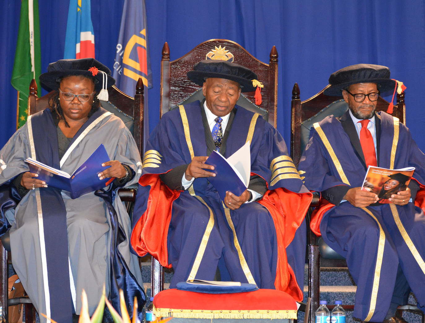 FROM LEFT: Kondjeni Nkandi, NUST Council Member; Hon Prof Peter Katjavivi, NUST Chancellor, and Dr Tjama Tjivikua, NUST Vice-Chancellor pictured paging through the Graduatuion booklets during the Graduation Ceremony last week Friday.