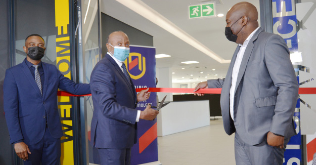 Left to right: NUST Vice-Chancellor, Dr Erold Naomab; Vice-President of Namibia, HE Dr Nangolo Mbumba; and Managing Director of MTC, Dr Licky Erastus, officially inaugurating the HTTPS building by cutting a ribbon.