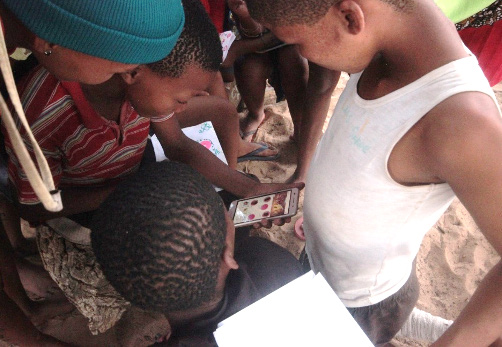 San children testing the counselling application on mobile phones.